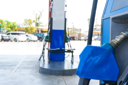 Gas nozzle in fuel oil station, Power business concept Stock Photo