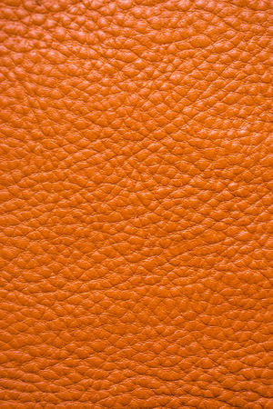 Genuine full grain leather tan color colose up background, Cowhide for crafsman Stock Photo