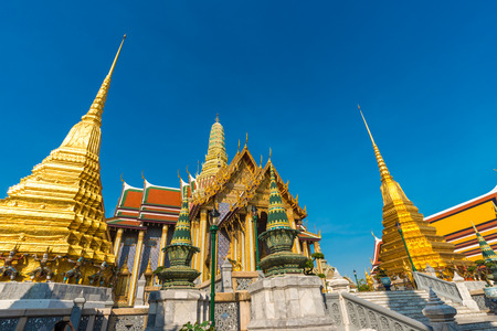 Golden pagoda with giant statue at Royal grand palace temple, Thailand Editorial