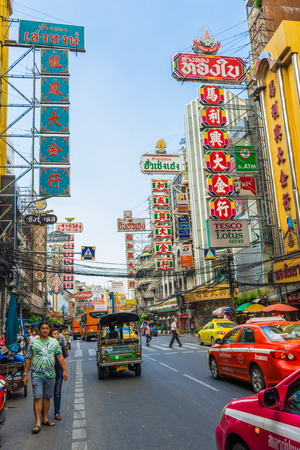 streetlife: Bangkok, Thailand - November 23, 2014 : Bright signs of the stores, restaurants and car on china town (Yaowarat) Road, once of Bangkok landmark street for more foods for thai-chinese style.