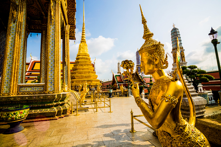 speculative: Beautiful Ki-nara angel stand front of pagoda temple in Bangkok as a tourist destination