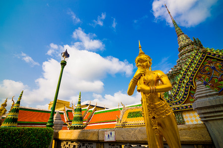 Beautiful Ki-nara angel stand front of pagoda temple in Bangkok as a tourist destination