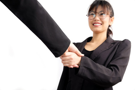 coporate: Asian business women shake hand with partner job success isolated on white background