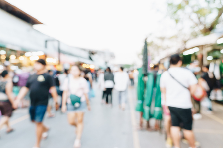 Blurred people shopping on weekend market street outdoor Chatuchak, Thailand