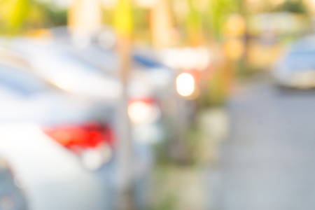 Abstract blurred car at parking lot outdoor, Background of car park Stock Photo