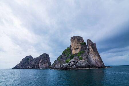 Rock island alone in Andaman sea with cloud before rain