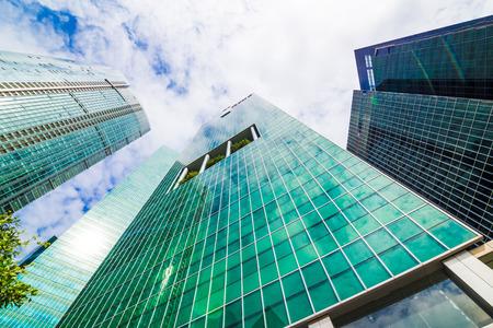 Skyscraper office building against sky uprisen view