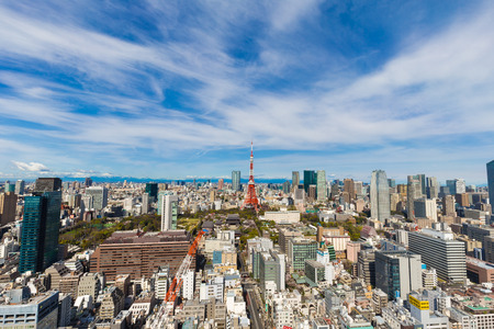 Tokyo cityscape of building and red tower blue sky background, Japn
