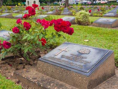 KANCHANABURI, THAILAND - AUGUST, 2015: Kanchanaburi War Cemetery in Thailand, Graveyard for soldiers and captives in the Kwai river bridge Editorial