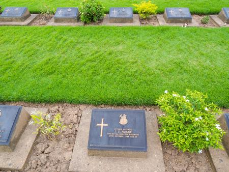 KANCHANABURI, THAILAND - AUGUST, 2015: Kanchanaburi War Cemetery in Thailand, Graveyard for soldiers and captives in the Kwai river bridge Editorial