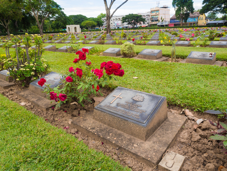 captives: KANCHANABURI, THAILAND - AUGUST, 2015: Kanchanaburi War Cemetery in Thailand, Graveyard for soldiers and captives in the Kwai river bridge Editorial