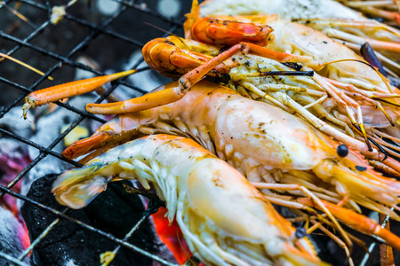 Delicious seafood prawn on grill with flames in background Stock Photo