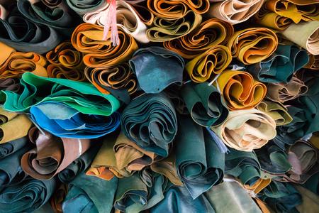 Leather craft roll up overlapse on shelf background for make wallet, shoe, bag, shirt