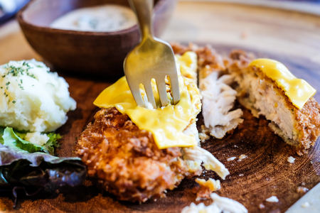 chinese spinach: Fried chicken with slive cheese on wood dish with mash potato