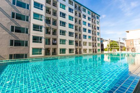 suburban neighborhood: Condomunium building with swimming pool sun shine and blue sky day