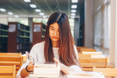 Student women reading book in serenity library