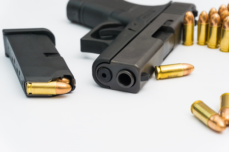 9mm pistol with copper full metal jacket bullet isolted on white background