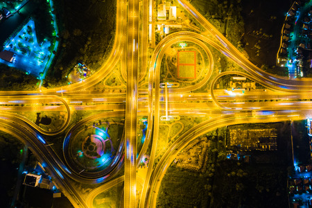 Look down view over the highway at night on expressway and motorway, Aerial view interchange of a city Stock fotó