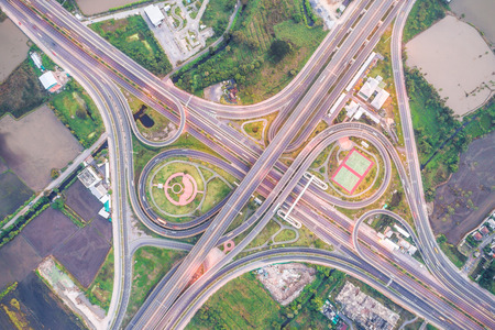 Overpas traffic intersection road topview with green tree in the morning, Transport concept