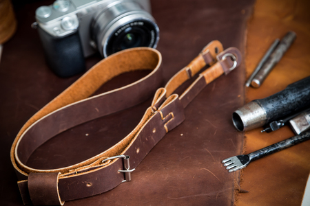 Mirrorless vintage camera with leather strap and tool of hand made, Hobby of photographer Stock Photo