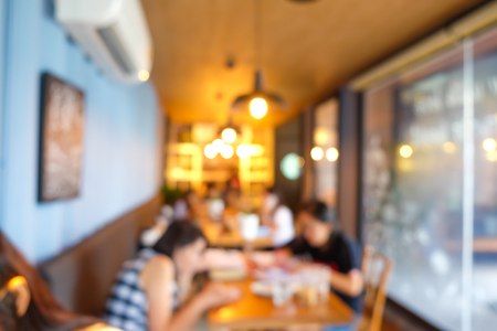Blurred group of people in art coffee shop vintage tone
