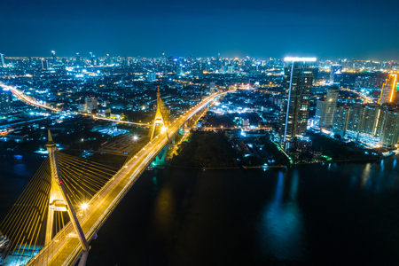 Express way bridge at night with light of traffic aerial view