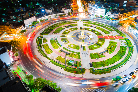 Circle junction traffic road with car light movement aerial view