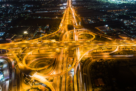 Aerial view night city traffic freway intersection road long exposer image