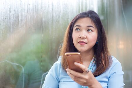 Social netwoek girl use smartphone looking for information in cafe