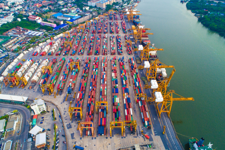 Logistic container shipping import and export pier with crane aerial view
