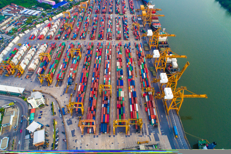 Cargo with container ship in dock at port, Aerial view of transport pier Stock Photo