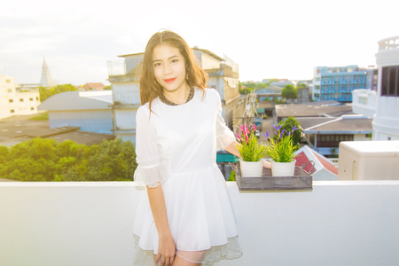Attractive asian woman in white dress fashion, building background