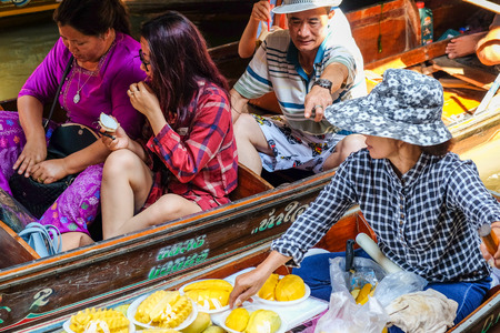 DUMNERN SADUAK FLOATING MARKET ,THAILAND-March 25: Tourist featuring many small boats with colourful fruits, vegetables and Thai cuisine in Dumnern Saduak Floating Market on March 25:,2017 in Thailand.