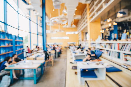 Blurred people co-working space in coffee shop business background