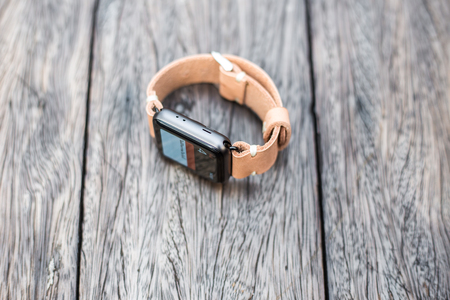 Smart watches with genuine leather craftsmanship work shop on wood