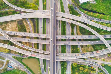 Intersection cross road with vehicle movement aerial view by drone, City transport