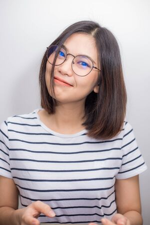 Pretty asian women with shirt and glasses smiling on white background