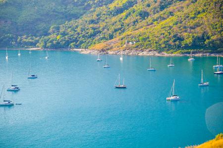 Mountain coastline seascape with yacht boat at Phuket island, Thailand