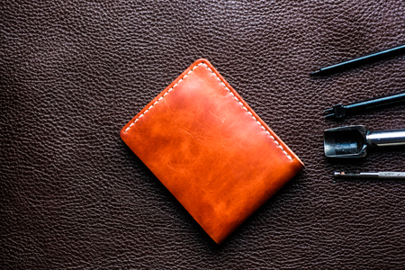 Brown genuine vegetable tanned leather on cowhide background, Craftsmanship object