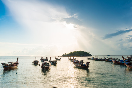 Fisery wooden boat sunrise morning with colorful sky, Lipe, Thailand