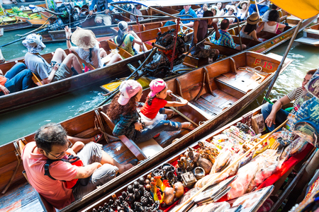 DAMNOEN SADUAK, THAILAND - MARCH 20 : Damnoen Saduak Floating Market Featuring wooden boats laden with colourful fruits, vegetables and Thai cuisine on March 20, 2016 in DAMNOEN SADUAK , THAILAND Editorial
