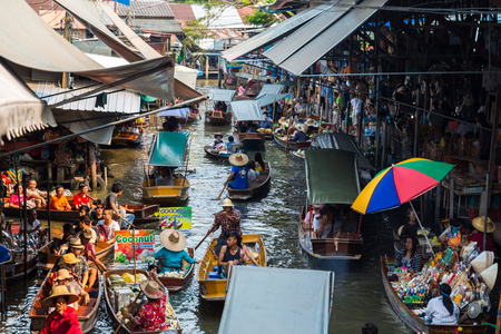 Travel boat at floating local market in Thailand with many fruit and vegetable from farm