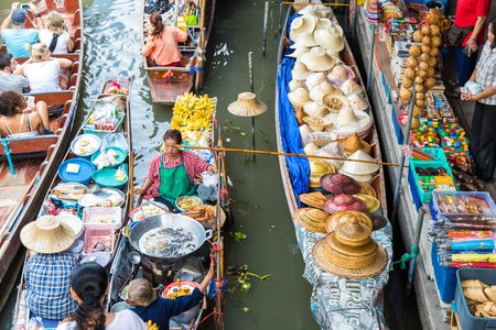 DAMNOEN SADUAK, THAILAND - MARCH 20 : Damnoen Saduak Floating Market Featuring wooden boats laden with colourful fruits, vegetables and Thai cuisine on March 20, 2016 in DAMNOEN SADUAK , THAILAND Editorial