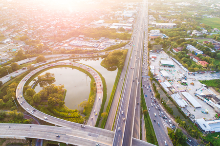 Aerial view transport junction road car movement with sunset light, Vehicle on road Reklamní fotografie - 100070640