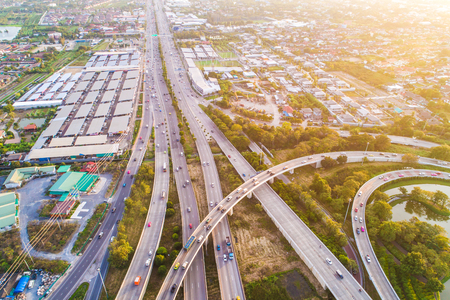 Aerial view transport junction road car movement with sunset light, Vehicle on road