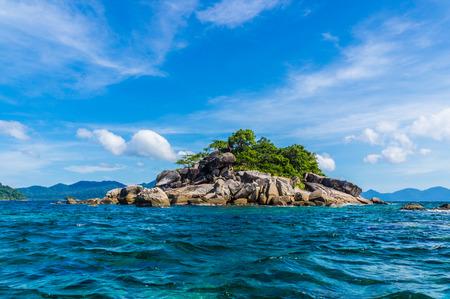 Seascape of rocky island on deep blue sea sunshine day, Lipe Thailand