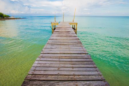 Wooden bridge with blue sky cloud sunrise in the sea, Koh Kut, Thailand Stock Photo