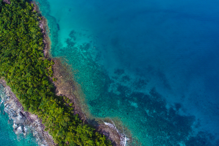 Rocky island sea beach with green tree aerial view, Nature seascape Stock Photo