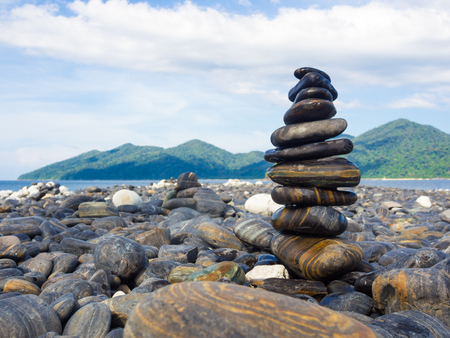 Black stone decoration on sea beach zen concept landscape background Stock Photo