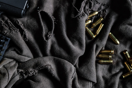 Full metal jacket 9mm ruger bullet on cloth texture arm object